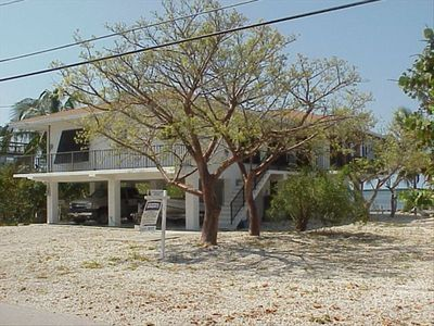 STILT HOME ON THE OCEAN. WITH VIEWS FROM KITCHEN, LIVING RM AND SCREENED PORCH