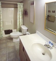 3rd & 4th bathrooms are also full size, with a tub and shower combination. - Branson cabin vacation rental photo