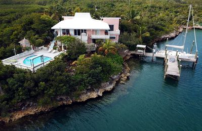 Charming and Secluded Home on the Bay with Pool, Dock, Views.