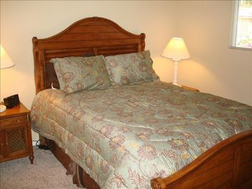 Second bedroom with queen bed, clock and phone