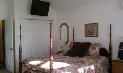 View of master bedroom with HDTV