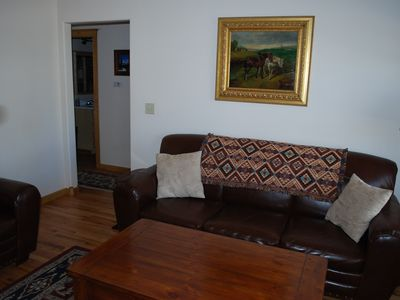 Cozy living room has a sofa & loveseat. Cable TV and a DVD player are provided.