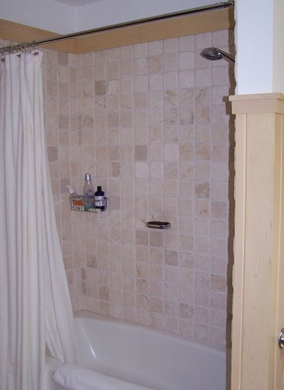 Bathroom tub and shower.