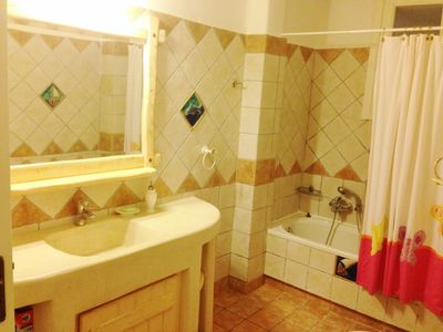 en-suite bathroom with toilet and BOSCH washer
