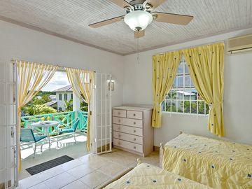 Bedroom Four, with balcony overlooking pool and West Coast