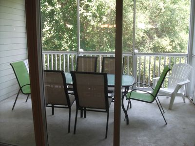 Screened in porch, new dining table also adarondak chairs and end tables.