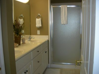 Master bath has double sinks, two head shower stall and huge walk-in closet