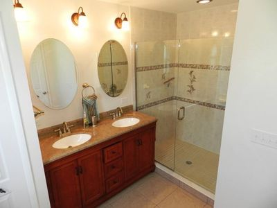 Master bath room, with dual sinks and large shower