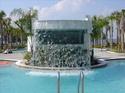 Cool off in the Waterfall pool only steps from your patio. Heated seasonally