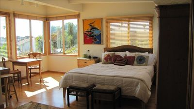 sunny large master suite with spectacular ocean and sunset views
