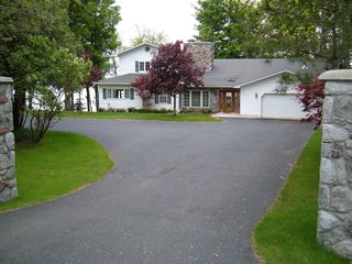 Burt Lake house photo - back road side of house