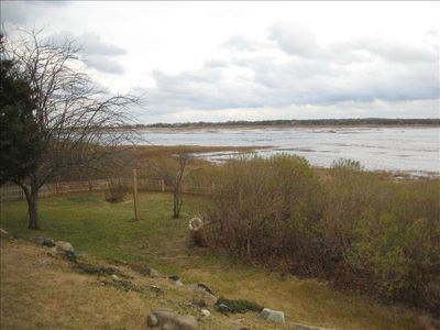 "View of the marsh, at high tide, with ""play pen"" in the foreground."