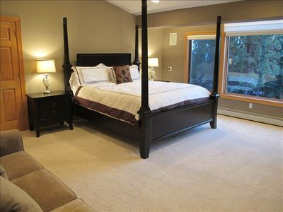 Master suite with a gorgeous four poster bed and fire place!