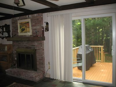 Dining area looks out on deck featuring gas grill with piped in natural gas.