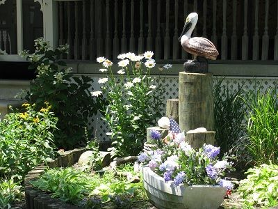 Our pelican overlooks our garden, thus the name 'Pelican Roost'.