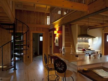 Kitchen and stairs to loft spaces