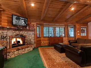 Bear Mountain cabin photo - Living room picture taken from kitchen. Family is all together with floor plan