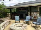 Outdoor kitchen with gas grill. Fire pit perfect for smores or a glass of wine