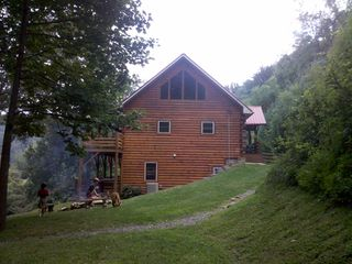 Maggie Valley lodge rental - Side view of Hickory Lodge. There are 2 firepits ready for marsh mellows!