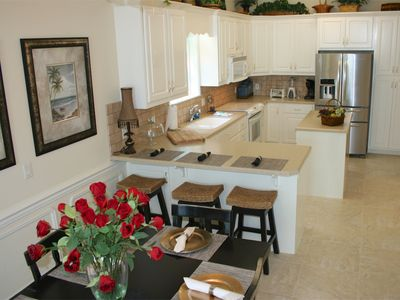 Kitchen:fully equipped, new frig, 3 bar stools, dining area for 6 with Gulf view