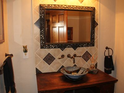 Florissant lodge rental - Guest bath with custom tile work and vessel sink