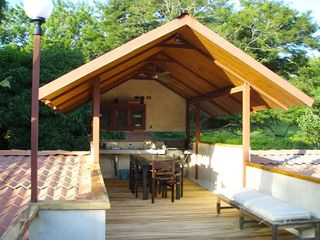 Tamarindo studio photo - Covered outdoor kitchen with gas BBQ and dining area on 2nd floor.