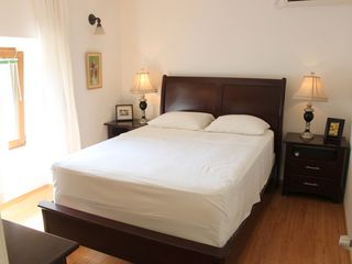 Dubrovnik villa photo - Rich wood furniture and soft white bedding feel luxurious.