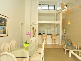 Napili condo photo - View of living room open floor plan. Flows into kitchen. Master suite on left.