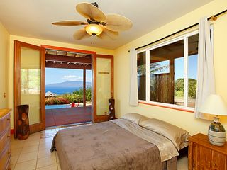 Lahaina house photo - Guest bedroom with full glass view doors onto lower lanai and pool deck.