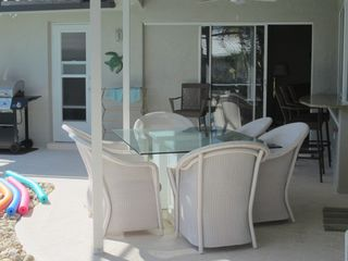 Vacation Homes in Marco Island house photo - Outdoor table w/ seating for 6, plus bar seating for 4