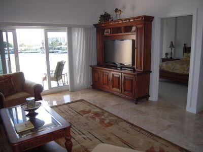 Enjoy your large flat panel TV or wait for the dolphins to swim past your balc