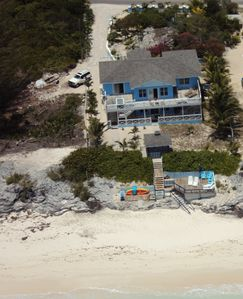 View of house from the ocean, showing sundeck, gazebo etc.