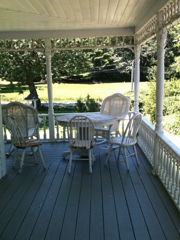 Wrap around porch with game table