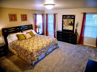 king size bed in masters bedroom with  flat screen TV, and full private bath