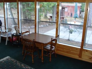 Lakewood cabin photo - enclosed porch area overlooking backyard