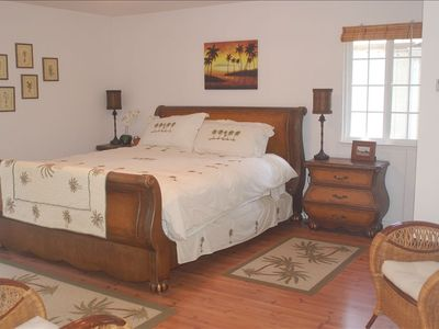 California King bed in master bedroom with pillow top matress, TV, DVD, and VCR