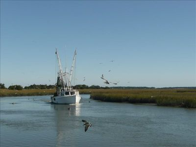 Shrimp boat next to island