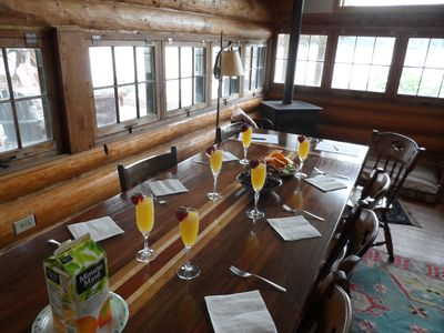 Breakfast with a lake view, eating on a crafted farm table, seats up to 12