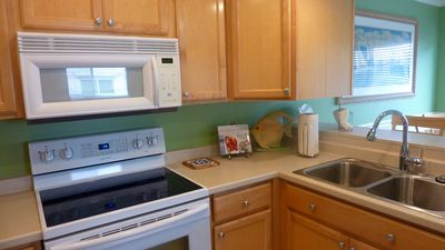 Fresh, clean kitchen stocked with cookware! All new appliances!