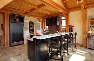 Gourmet kitchen with gated pantry and eating bar