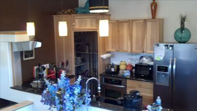 Full equipt Modern Kitchen with Hickory Cabinets and Granite Counter Top.