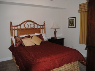 Calypso Resort condo photo - The guest bedroom has a queen bed and Tommy Bahama furnishings. Nice TV also,
