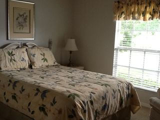 Vacation Homes in Marco Island house photo - Guest bedroom has queen bed, dresser, chair