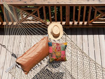 Relax on the porch in a double hammock