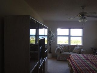 Cape Canaveral condo photo - Master bedroom; entertainment center, TV, music