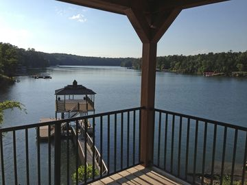Lewis Smith Lake cottage rental - View looking left from deck toward new boathouse with swim pier and boat lift.