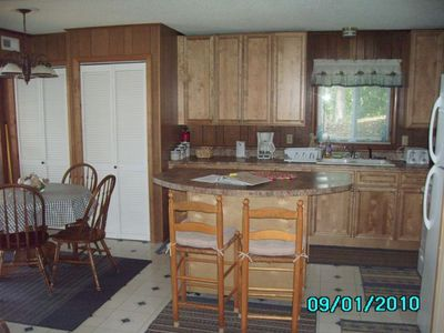 Kitchen re-modeled with Cedar Cabinets and updated Appliances