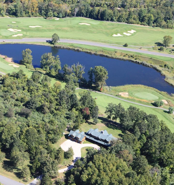 Sherman lodge rental - The Lodge in trees, high above the 2nd fairway, 17th green and trout pond
