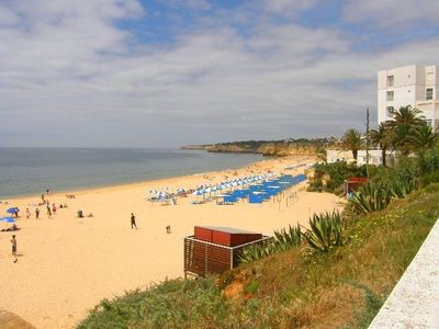 Golden sandy beach in armacao de pera