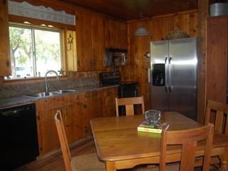 Bastrop cottage photo - Kitchen and dining area table has leaf& will seat 6.
